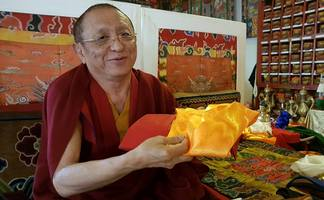 Chokyi Nyima Rinpoche accepts annual offering from Dharma Ratna team