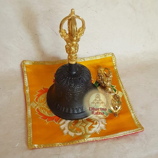 Vajra and bell on brocade mat
